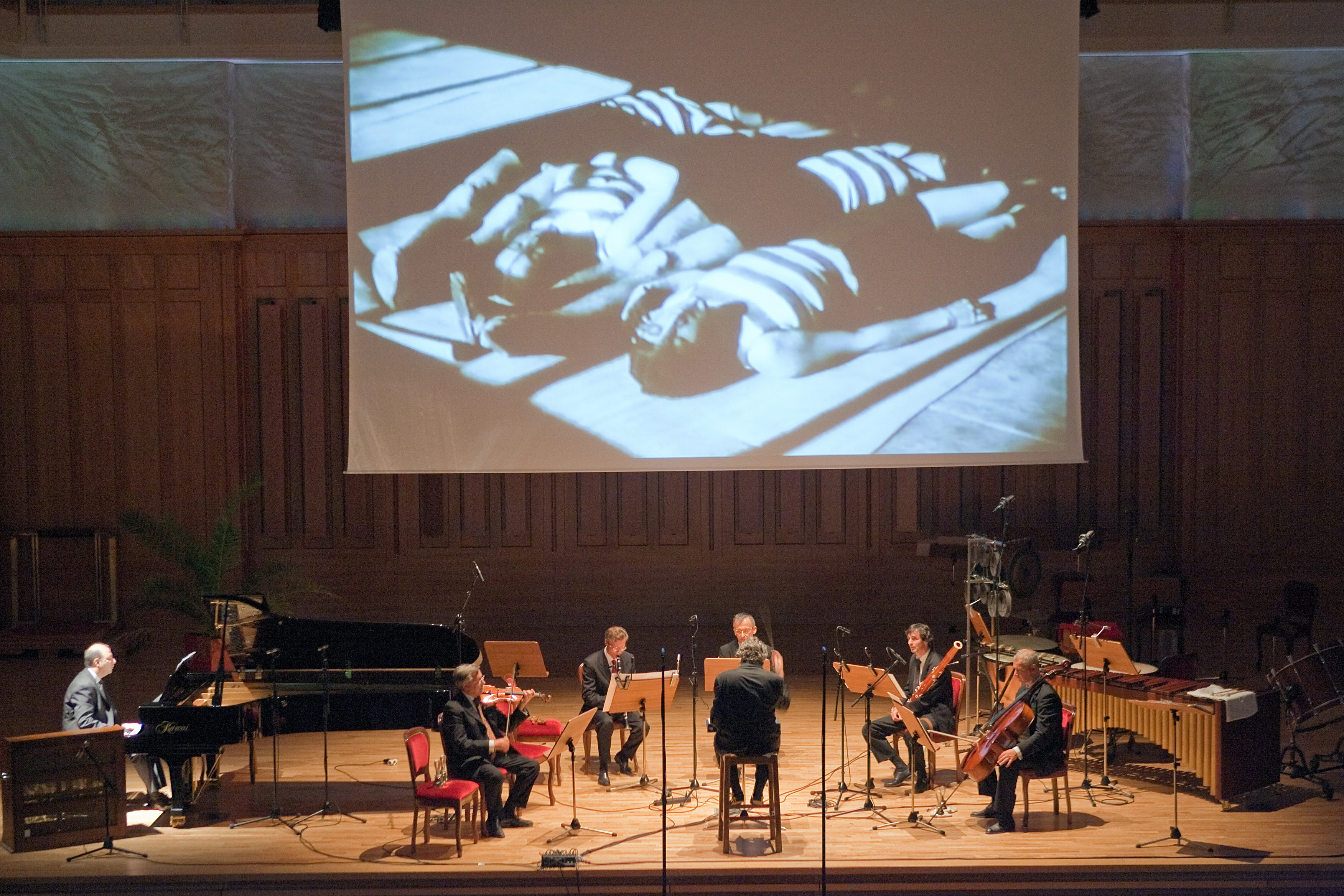 MAN RAY, LES MYSTÈRES DU CHÂTEAU DE DÉ, WITH MUSIC BY GEORGES AURIC, ACTOR IN THE FILM. ALBERTO CAPRIOLI CONDUCTING THE EX NOVO ENSEMBLE, DOBBIACO, GUSTAV MAHLER MUSIKWOCHEN, JULY 13, 2010, PHOTO MAX VERDOES